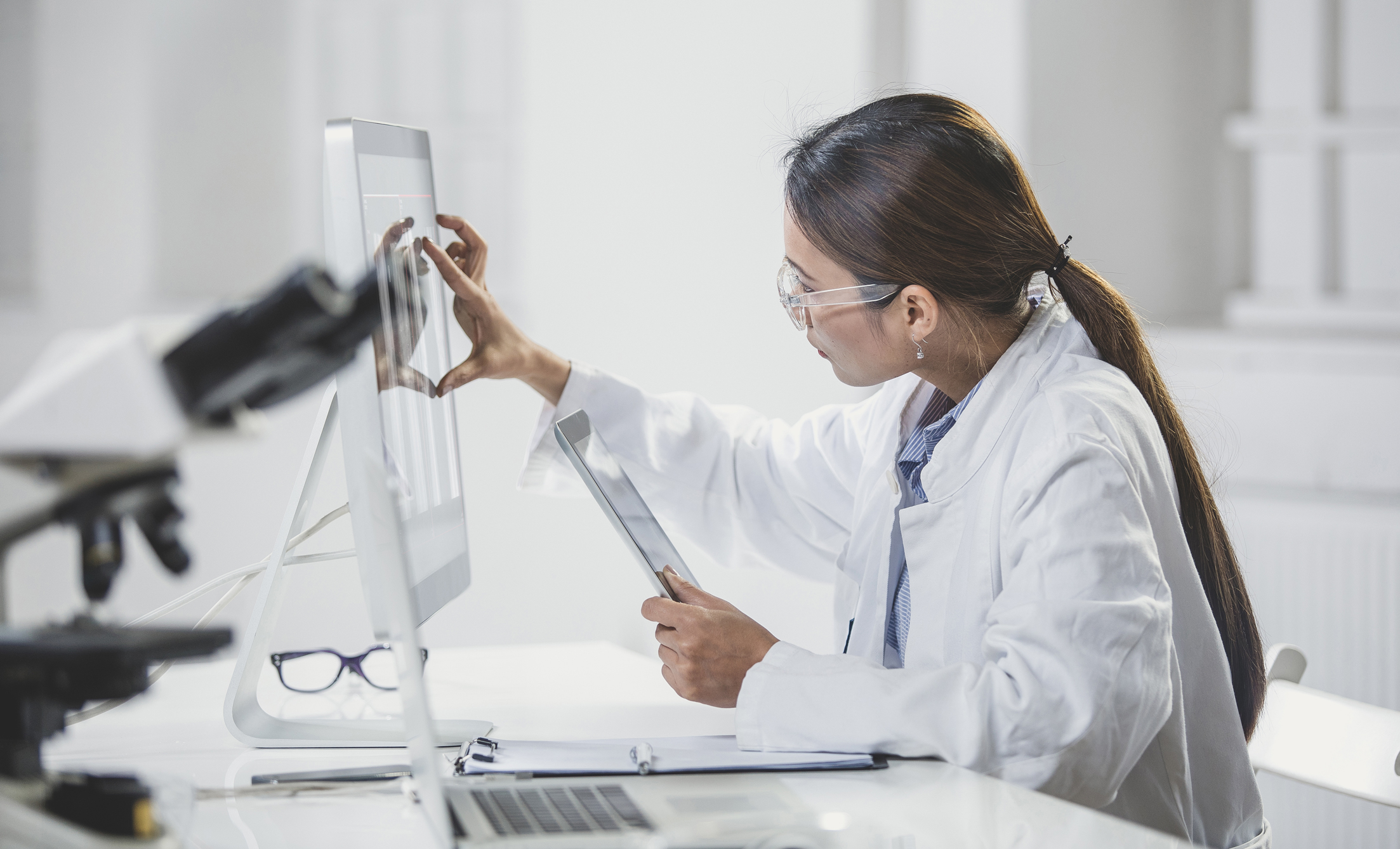 Scientist in lab looking at computer screen