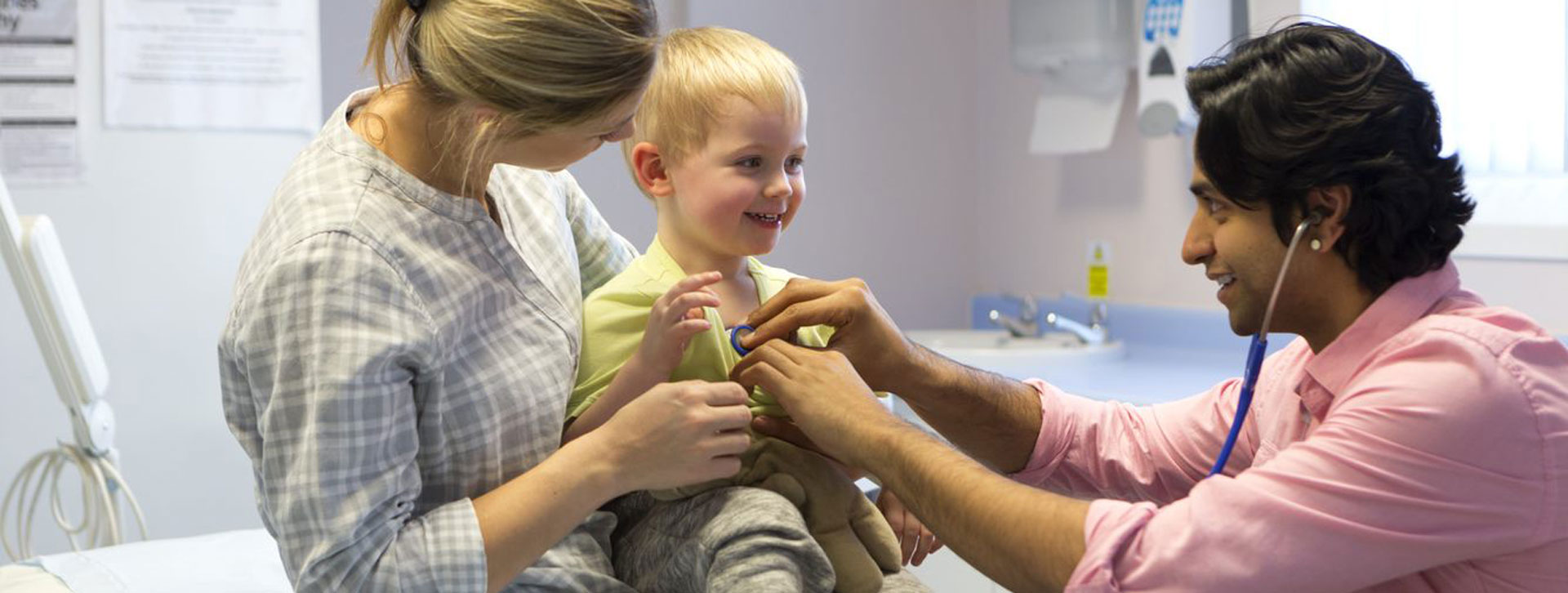 Small child smiles at doctor